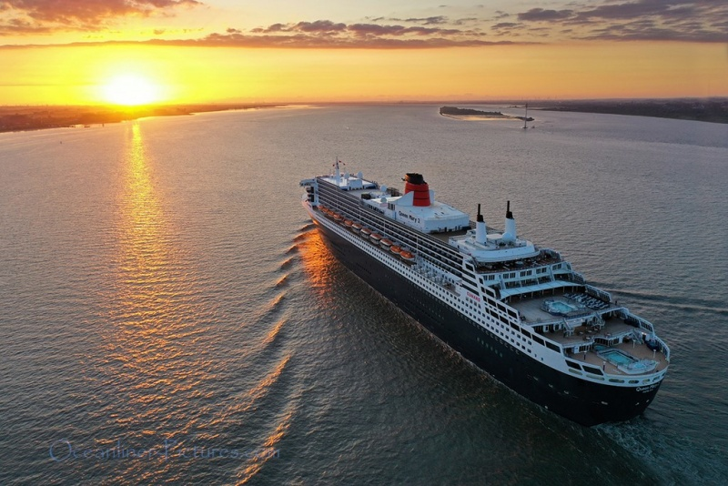 Queen Mary 2 cruising on the Elbe river at sunset